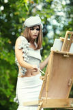 Woman is painting Royalty Free Stock Photography