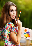 Woman is painting Stock Photo