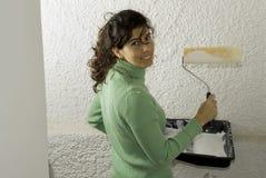 Woman Painting A Wall - Horizontal Stock Image