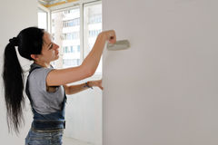 Woman painting an apartment Royalty Free Stock Photos