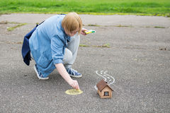 Woman painting a on asphalt Stock Image