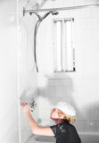 Woman Painting in the Bathroom stock image