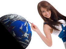 Woman painting the blue earth Stock Image