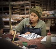 Woman Painting Ceramic Tile, Baja, Mexico Royalty Free Stock Image