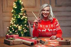 Woman painting christmas flags with brush Stock Photo