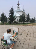 Woman painting church, Suzdal, Russia Stock Images