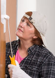 Woman painting door Royalty Free Stock Images