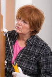 Woman painting door Royalty Free Stock Photos