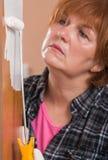 Woman painting door Stock Photos