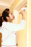 Woman painting door frame Royalty Free Stock Photography