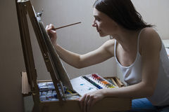 Woman Painting On Easel Stock Images