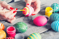 Woman painting easter eggs royalty free stock photo