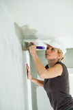 Woman Painting the Edges of the Ceiling Royalty Free Stock Photo