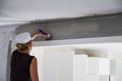 Woman Painting the Edges of the Ceiling Stock Photography