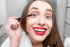 Woman painting eyelashes Royalty Free Stock Photo