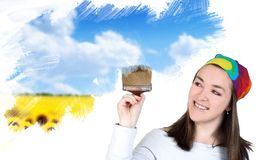 Woman painting a field Stock Photo