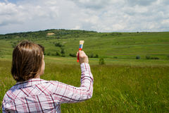 Woman painting a field Royalty Free Stock Photography