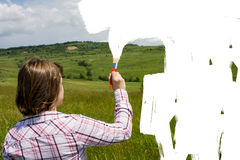 Woman painting the field to white Royalty Free Stock Photo