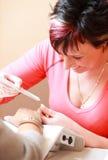 Woman painting fingernails Royalty Free Stock Photos