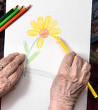Woman painting flower Royalty Free Stock Photo