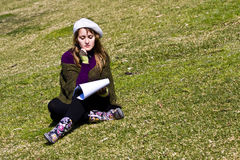 Woman painting on the grass Stock Photography