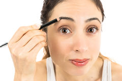 Woman painting her eyebrow Stock Photo