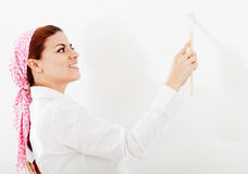 Woman painting her house Stock Photos