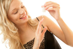 Woman painting her nails. POrtrait of young happy woman painting her nails isolated on white background Stock Images