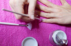 Woman painting her nails Royalty Free Stock Photo