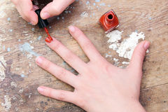 Woman painting her nails Stock Photography