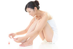 Woman painting her toenails Royalty Free Stock Photography