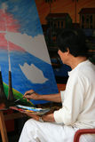 A woman is painting in her workshop in Hoi An (Vietnam) Royalty Free Stock Photo