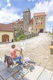 Woman painting Hohnstein castle. Royalty Free Stock Images