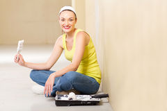 Woman painting home Stock Images