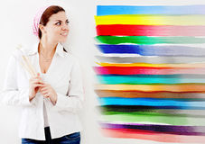 Woman painting the house Royalty Free Stock Images