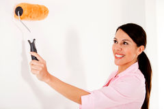 Woman painting house Stock Photos