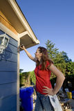 Woman Painting a House - Vertical Royalty Free Stock Photo