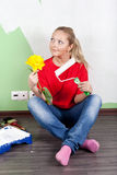 Woman painting interior wall of home Stock Image