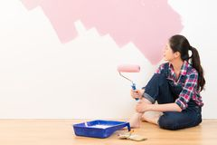 Woman painting interior wall of new house Stock Image
