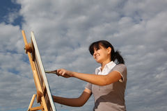 Woman painting landscape Stock Photo
