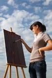 Woman painting landscape Stock Images