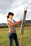 Woman painting landscape Royalty Free Stock Image
