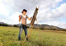 Woman painting landscape Stock Image