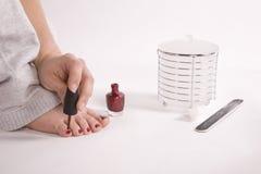 Woman painting nails Stock Photo
