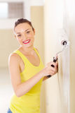 Woman painting new home Stock Photo