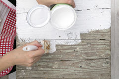 Woman painting old table Stock Image