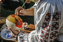 Woman painting ostrich egg Royalty Free Stock Photo