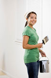 Woman painting with paint brush Royalty Free Stock Photos