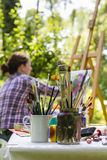 Woman painting with paint brush Royalty Free Stock Image