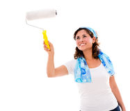 Woman painting with paint roller Stock Photo